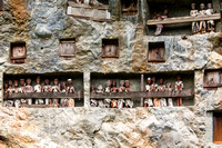 Cliffside burials and effigies at Lemo in Toraja