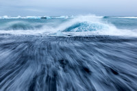 wave wash on a black sand beach