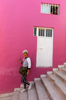 steep steps in front of pink house