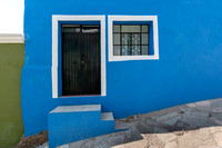 blue house on steep incline